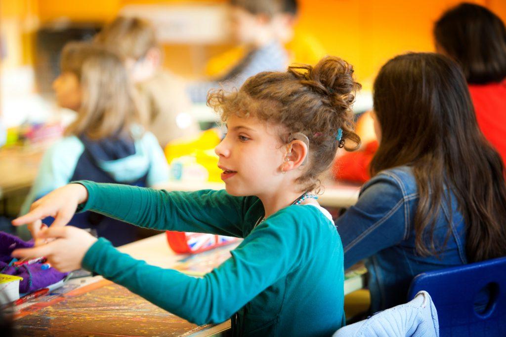 cochlear-implant-girl-in-school